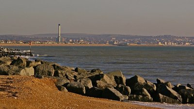 Lancing Beach - Looking east towards Shoreham Power Station and Hove, with rock sea defences on the beach. (© © Copyright Ian Capper (http://www.geograph.org.uk/profile/16999) and licensed for reuse (http://www.geograph.org.uk/reuse.php?id=1091924) under this Creative Commons Licence (https://creativecommons.org/licenses/by-sa/2.0/))