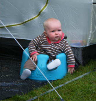 A tip for first family campsite trips - A child in a Bumbo seat on a family campsite keeps them safe while you're cooking!