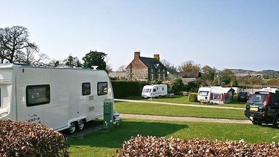 Photo of tourers on the park