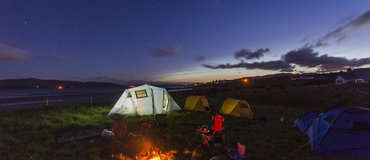 A campsite at night - Books on camping