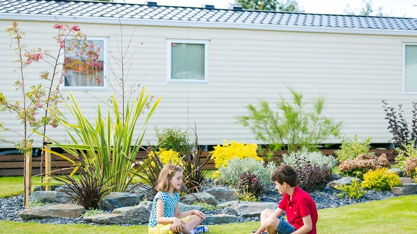 Children playing on the pitch at Willowbank Holiday Home and Touring Park (© Willowbank Holiday Home and Touring Park)