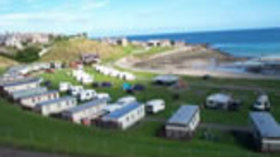 Aerial view of the caravan park with static holiday homes