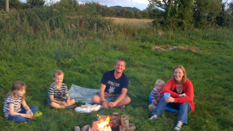 Family round fire - One of the many young families enjoying the outdoor life