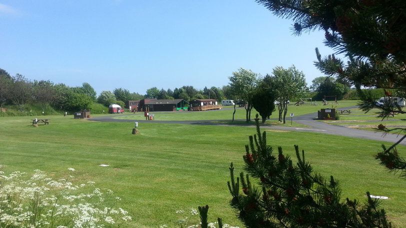 Standard touring pitch - Lovely level grass pitches with and without hook up for caravans and motorhomes