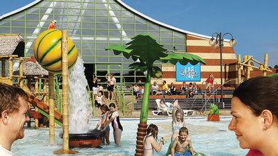 The Splash Zone at Vauxhall Holiday Park - The Splash Zone outdoor pool area and sunbathing terraces. A water wonderland where kids can swim and splash around. Parents can stretch out on the sunbathing terraces or enjoy a snack or drink by the pool.