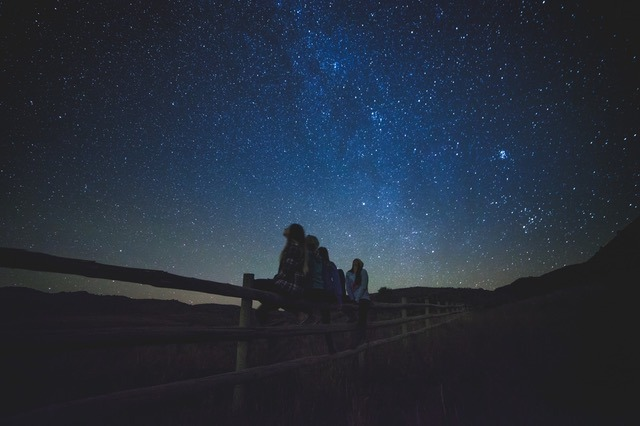 People looking at the stars at night