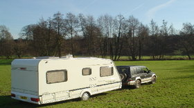 Touring caravan on site