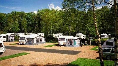 Touring caravans on Craigie Gardens Caravan Club Site, Ayrshire, Scotland