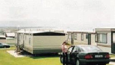 Holiday homes with a car on the parking on the park