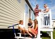 2014-St-Osyth-Family-Decking-Caravan-Children-Playing-on-Grass-(4)