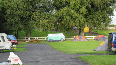 Tents pitched on Carra Caravan and Camping - Horsedrawn caravans and country walks are a speciality at this picturesque family run park in Mayos
