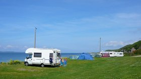 Pitch by the sea at Muasdale Holiday Park, Scotland - For a caravan holiday in Scotland with a perfect sea view, Caravan Sitefinder recommends the award-winning Muasdale Holiday Park near Argyll  (© Muasdale Holiday Park)