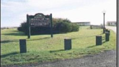 Entrance to the caravan park with a sign
