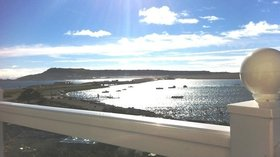 The stunning view overlooking Portland Harbour, the Fleet Lagoon and Chesil Beach