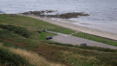 Banff Links carpark and 'The Tumblers' near the caravan site (© © Copyright Stanley Howe (http://www.geograph.org.uk/profile/7629) and licensed for reuse (http://www.geograph.org.uk/reuse.php?id=3127420) under this Creative Commons Licence (https://creativecommons.org/licenses/by-sa/2.0/).)