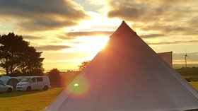 Holidays in Padstow, Cornwall - Tent field at sunrise, Atlantic Bays Holiday Park