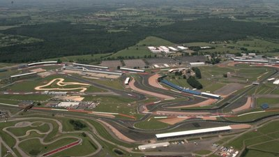 Silverstone Circuit with Brackley Hatch behind- aerial 2017  - Nearby: Silverstone Circuit with Brackley Hatch behind- aerial 2017 (© © Copyright Chris (https://www.geograph.org.uk/profile/79357) and licensed for reuse (https://www.geograph.org.uk/reuse.php?id=5436763) under this Creative Commons Licence (https://creativecommons.org/licenses/by-sa/2.0/).)