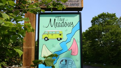 The Meadows Sign - A picture of the entry sign to The Meadows Campsite on a nice sunny day