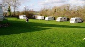 Photo of Milton Bridge Caravan Park pitches - Nice view on some tourers at Milton Bridge Caravan Park