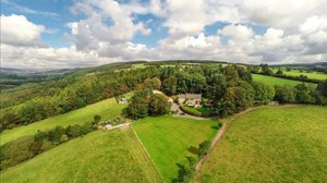 North Yorkshire holidays - Aerial view of the Barn at Rigg End and surrounding countryside