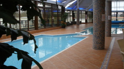 Picture of the heated indoor swimming pool at  Eryl Hall Caravan Park, Denbighshire, Wales, LL17 0EW - Relax in style. Our beautiful heated indoor swimming pool offers the ultimate for every generation. No matter what the weather, or time of year, the enticing water is perfect for having fun with the family or unwinding from the stress and strains of everyday life. Adult only swim session ensure a happy balance for all