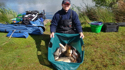 Happy angler with a bag of mixed fish (© Broom Leisure Ltd)