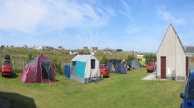Tourers and tents on the caravan park