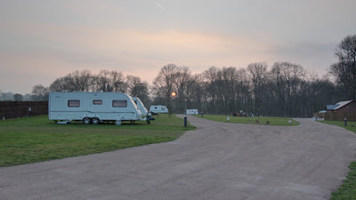 Pitched caravans - Sun sets across caravans on Forest and Wye Valley Camping Site