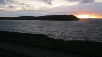 By Andrew Bone from Weymouth, England (Sunset beyond Stepper Point from Polzeath) [CC BY 2.0  (https-::creativecommons.org:licenses:by:2.0)], via Wikimedia Commons (© By Andrew Bone from Weymouth, England (Sunset beyond Stepper Point from Polzeath) [CC BY 2.0  (https://creativecommons.org/licenses/by/2.0)], via Wikimedia Commons (original photo: https://commons.wikimedia.org/wiki/File:Sunset_beyond_Stepper_Point_from_Polzeath_(8016289910).jpg))